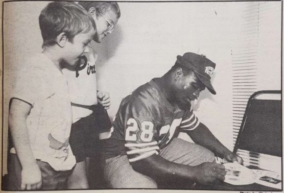 """Cougar cornerback Chuck Weatherspoon signs autographs for two young cancer patients"". By mid-October the team was ranked number 6th nationally. 