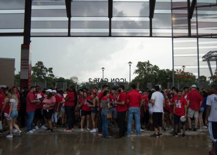 Faithful fans sought shelter from periodic downpours during the weather delay. | Ajani Stewart/The Cougar