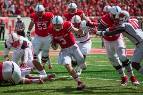 Backup quarterback Kyle Postma led the charge for the Cougars on Saturday by rushing for over 100 yards and two touchdowns. | Justin Cross/The Cougar