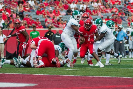 Senior quarterback Greg Ward Jr. scores his 38th career rushing touchdown in a 30-18 win over Tulane. | Justin Cross/The Cougar