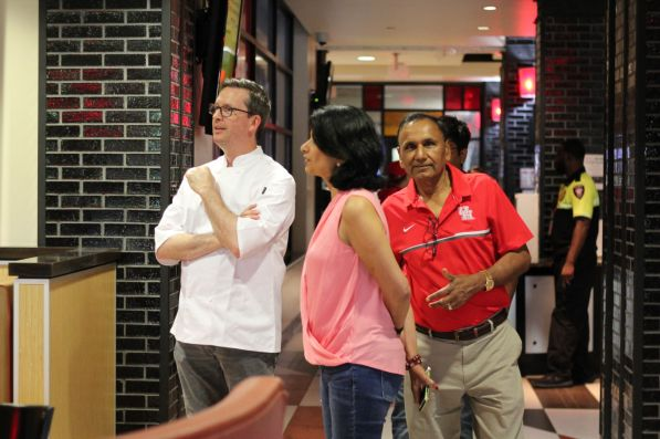 Chartwells District Manager David Riddle welcomes President and Chancellor Renu Khator and her husband, professor of industrial engineering Suresh Khator, at a dining hall Saturday for lunch. | Thomas Dwyer/The Cougar