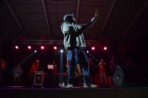 """Mike Jones holds up three fingers while performing his 2014 song """"3 Grams."""" 