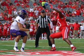 Alum safety Terrell Williams fought for balance after intercepting a pass. Although Houston allowed East Carolina to pass for 463 yards and three touchdowns, it still won the game by a large margin. | Thomas Dwyer/The Cougar