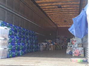 By midafternoon, more supplies had trickled in with one generous donor bringing his truckbed full of water bottles to donate (left). | Andres Chio/The Cougar