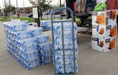 The Green family delivered a truckload of water to be donated. | Andres Chio/The Cougar