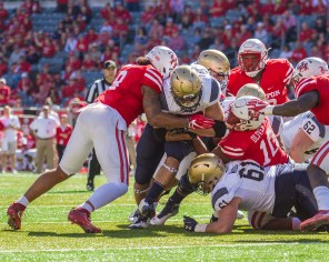 With the game tied 7-7, Navy tried to go for it on fourth down at Houston's two-yard line to take the lead, but Houston held strong and stopped the runner. | Richard Fletcher Jr./The Cougar