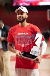 Senior Galen Robinson Jr. celebrates with the trophy. | Ahmed Gul/The Cougar