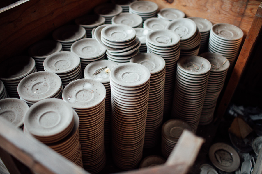 stacks of plates in an abandoned factory