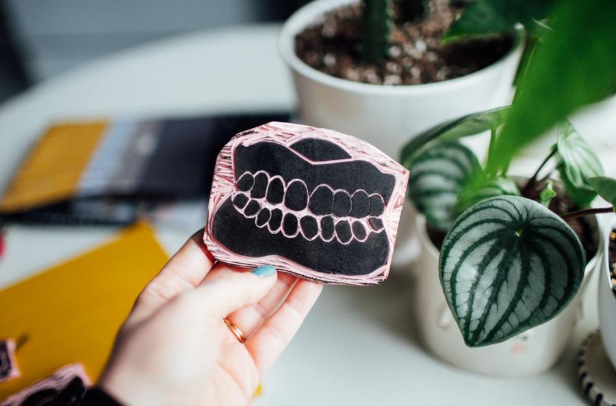 hand carved stamp of dentures