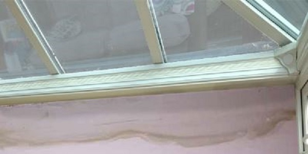 damp where conservatory meets house