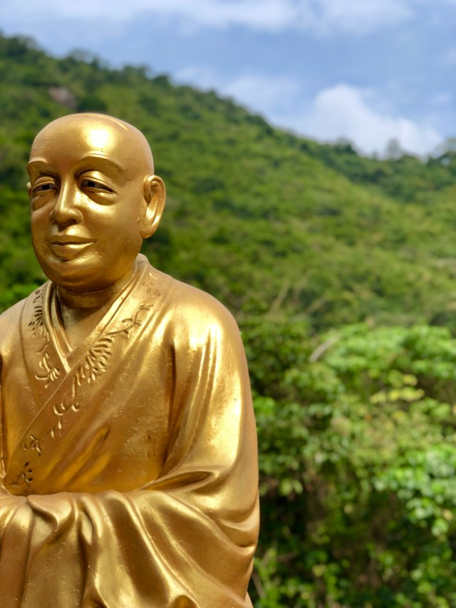 Golden Buddha with Green Jungle in the background. 4 Days in Hong Kong: Markets and Monasteries  www.thedancingcircustraveller.com