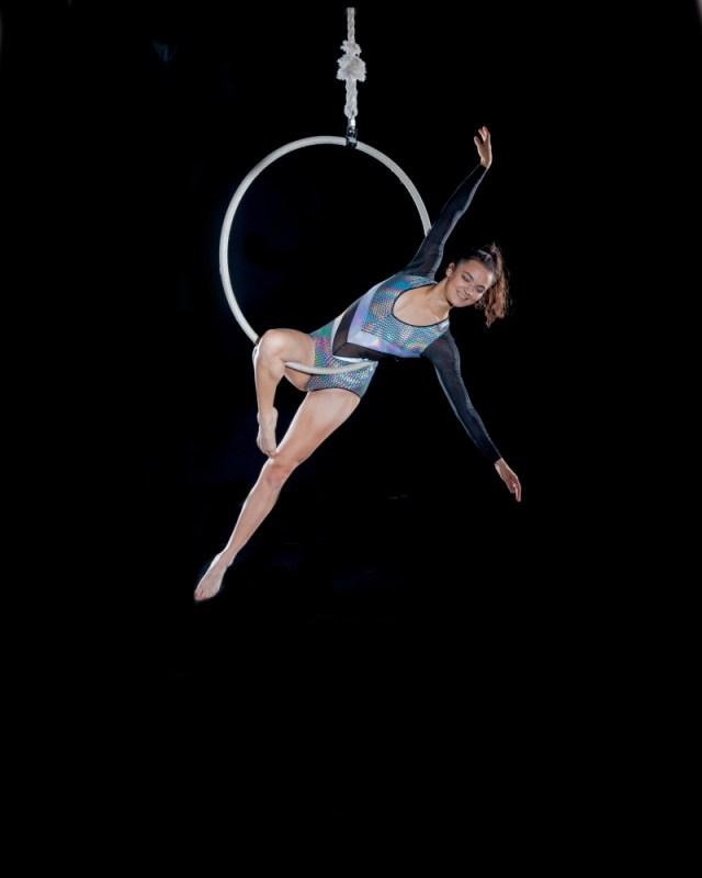 Dancing Circus Traveller posing on an aerial hoop