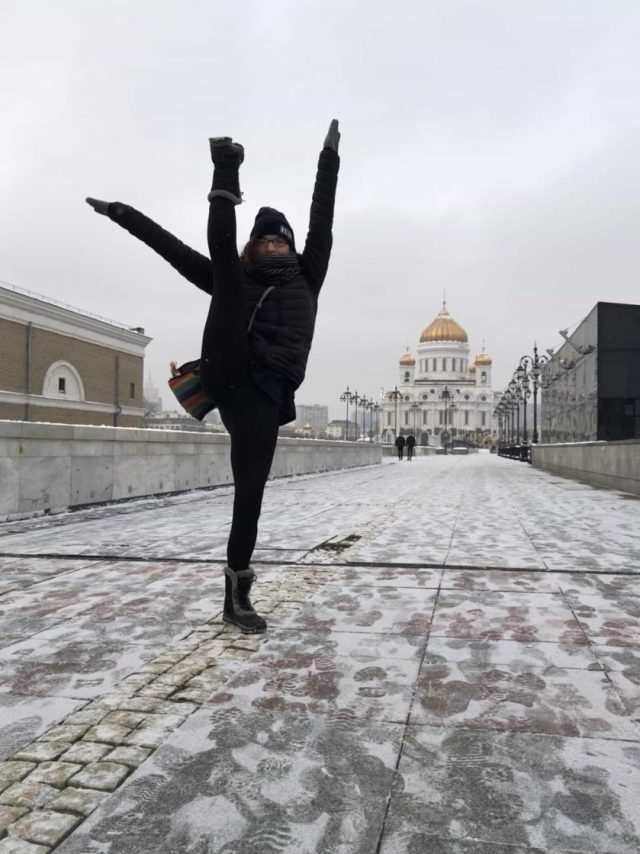 Girl doing high kick in front of Cathedral of Christ the Saviour