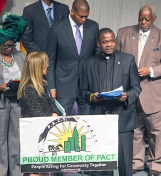 March 14, 2016 MARLENE QUARONI | FC Msgr. Chanel Jeanty, president of PACT and pastor of St. James Church, addresses the PACT assembly. Members of PACT rally for affordable housing and juvenile justice reforms at their Nehemiah Assembly.