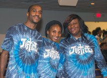 """March 14, 2016 MARLENE QUARONI   FC Evan Allen, Terrica Allen and Sharon Henley of St. Peter Missionary Baptist Church proudly show their """"Justice"""" T-shirts at PACT's Nehemiah assembly. Members of PACT rally for affordable housing and juvenile justice reforms at their Nehemiah Assembly."""