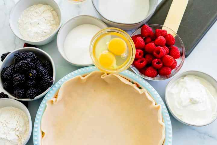 All the ingredients for double berry pie sit on the counter ready to combine.