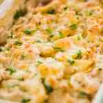 Golden brown, cheesy Au Gratin potatoes sit in a decorative casserole dish ready to enjoy.