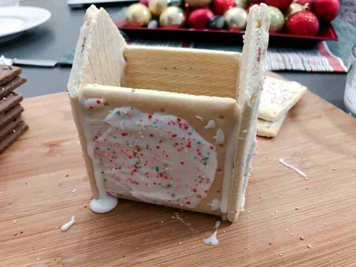 Pop Tarts are held together by royal icing to make the base house structure.
