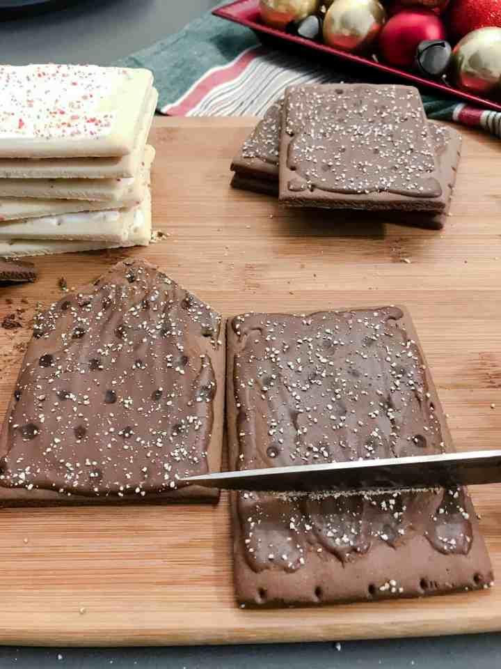 Two pop tarts are positioned next to one another ready to be cut into shape for making houses.