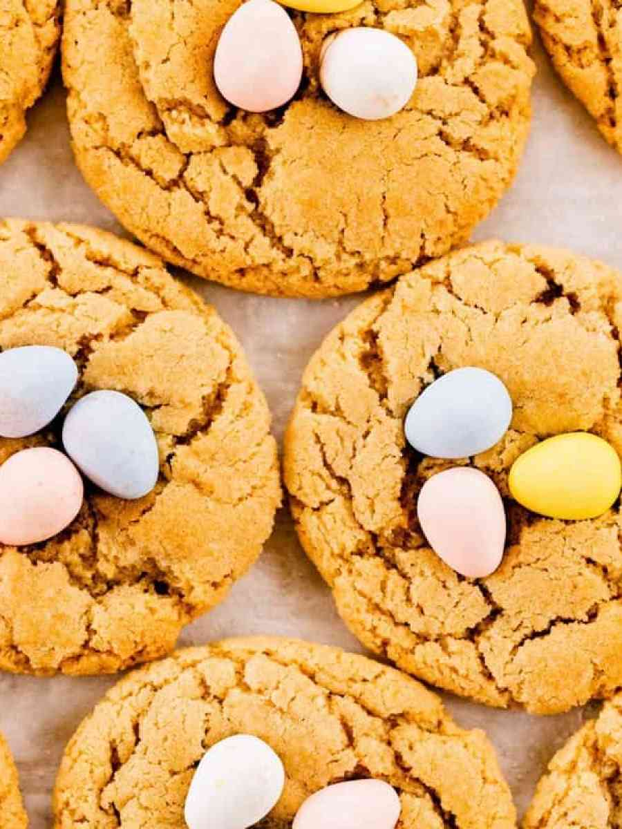 Bird nest Spring Blossom cookies sit on a tray near each other.