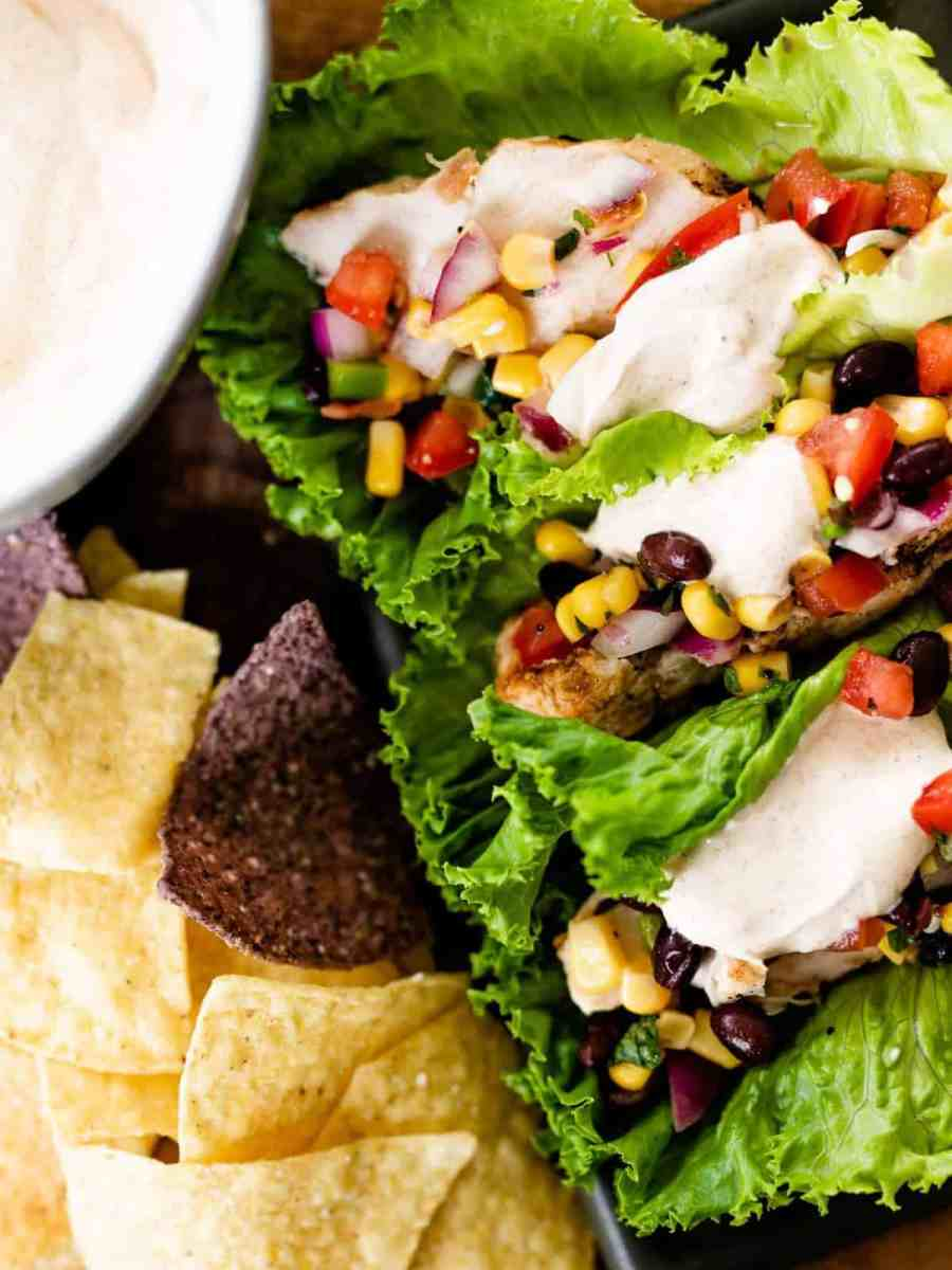 Southwest wraps sit on a bed of crisp tortilla chips ready to serve.