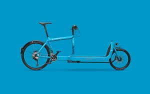 A photo of a blue e-cargo bike