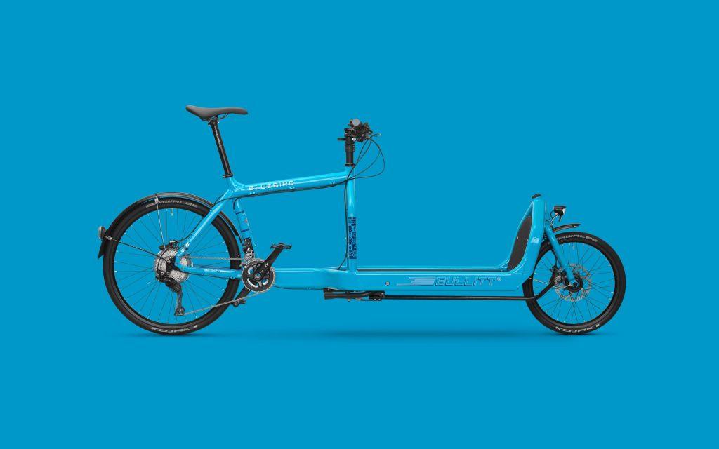 A photo of a blue e-cargo bike