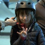Young girl wearing a skateboard helmet