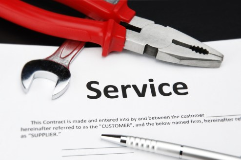 A blank service contract surrounded by hand tools
