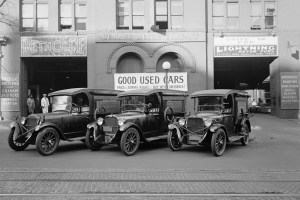 Old cars at a sales and repair facility.