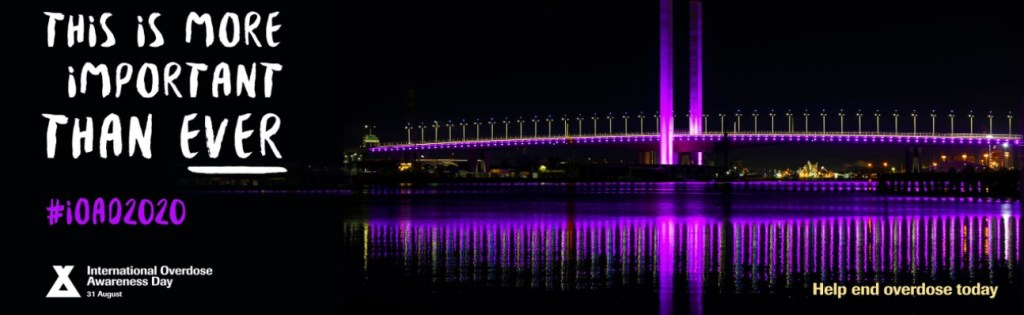 A bridge is lit in purple, the official color of International Overdose Awareness Day.