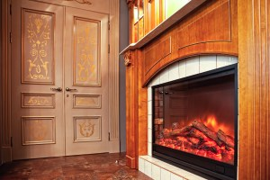 An electric insert is place in an oak mantle.