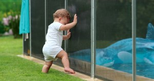A pool fence prevents a toddler from falling in.