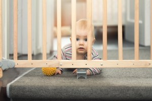 A gate prevents a baby from falling downstairs.