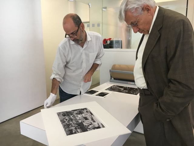 Michael Rubin helps a customer with matting and framing