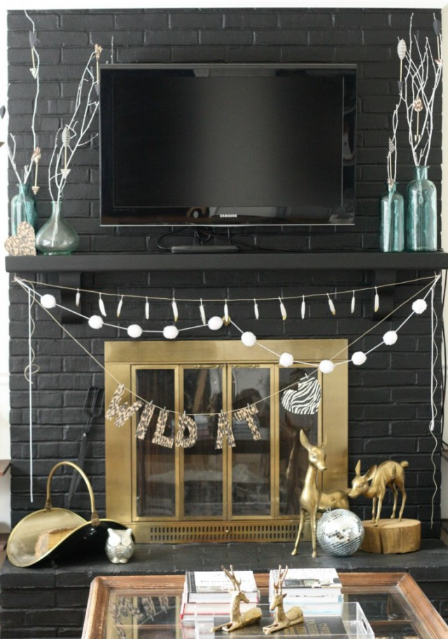 """Decor """"Quick Fix""""-Hide an unused fireplace with large art."""