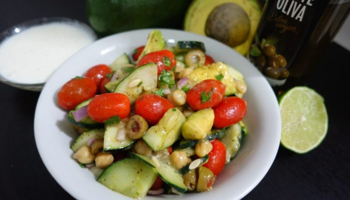 tomatoes, cucumbers, red onion, olives, avocado, chickpeas or beans, coriander, olive oil, chilli sauce, seasoning, served with yogurt