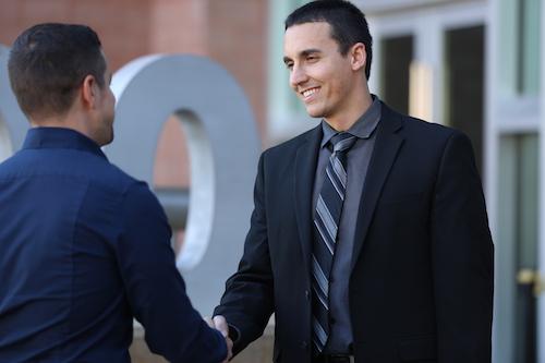 Criminal Defense Attorneys Ryan Helmick shaking client's hand