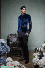 A royal blue, velvet bandhgala with intricate trellis work and gota embroidery on the sleeves, waist belt and collar. Teamed with a black kurti and jodhpur trousers.