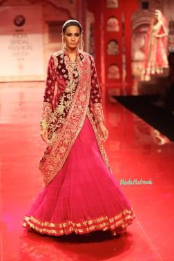 Red velvet jacket with pink net lehenga