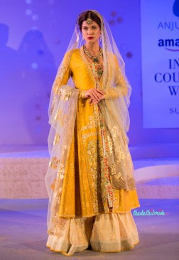 Yellow jacket with beige lehenga and a gold foil print dupatta