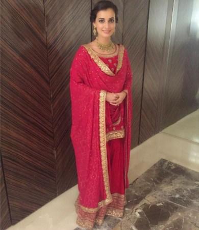 Wedding guest style - Sangeet - Dia Mirza in a red & hot pink Sabyasachi sharara - Masaba Gupta and Madhu Mantena Wedding 2015