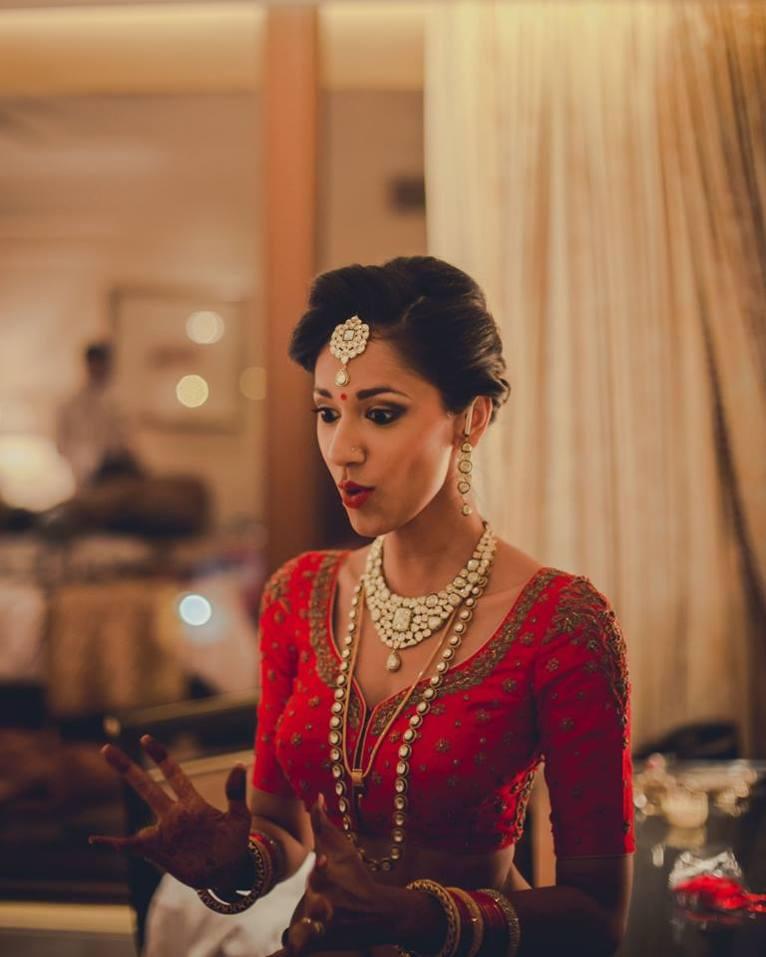 Reception - Getting ready 2 - embroidered red bridal blouse - Anasuya Wedding Wardrobe