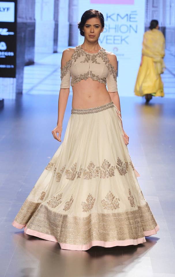 Ivory lehenga with silver embroidery and pastel pink border by Anushree Reddy at Lakme Fashion Week Summer Resort 2016