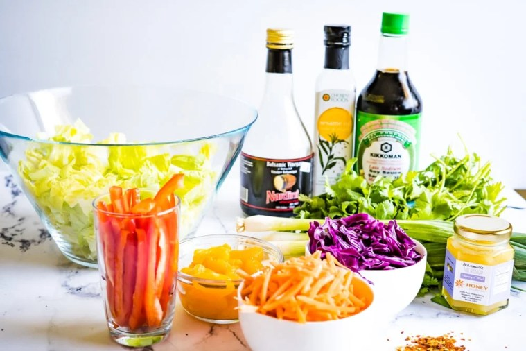 Group shot of all the ingredients needed to make a Chinese Chicken Salad