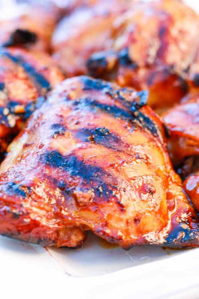 Close up of a piece of a Honey Sriracha Grilled Chicken Thigh with grill marks