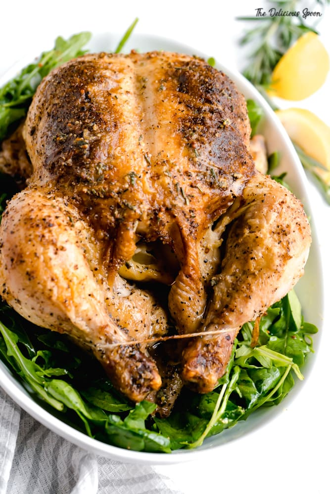Whole Roasted Chicken on a bed of arugula