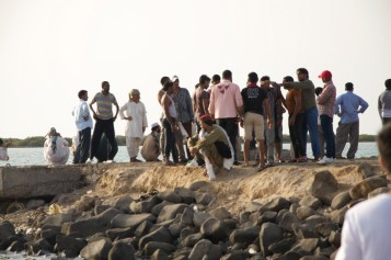 group of expats just looking at the sea