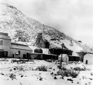 Lila C Mine - Shaft and Mill Building during rare snow storm 1912, Courtesy National Park Service, Death Valley National Park