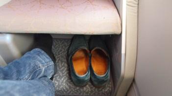Amble storage under footrest